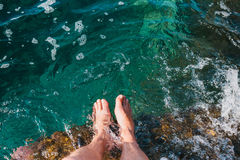 Two feet dipping  in water.Foot spa. Relax Royalty Free Stock Images