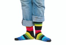 Two feet in multi-coloured socks Stock Image