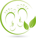 Two feet and plant, leaves, foot care and orthopedics logo Royalty Free Stock Photos