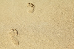 Two feet prints on the sand Stock Photos