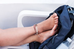 Two feet. Relaxation foot on a chair Stock Images