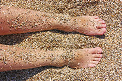 Two feet in sand Royalty Free Stock Images