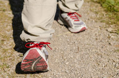Two feet with shoes are hiking Stock Photography