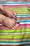 Two feet on striped towel Stock Photos