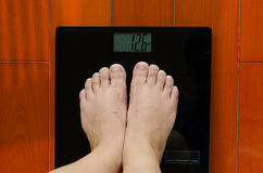 Two feet on the weighing-machine Royalty Free Stock Photos