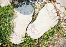Two feets of stone Stock Photo