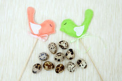 Two felt birds with quail eggs Royalty Free Stock Images