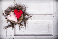 Two felt hearts in a nest Royalty Free Stock Image
