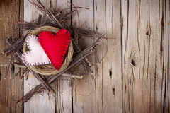 Two felt hearts in a wooden nest Royalty Free Stock Photography