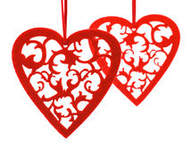 Two felted red hearts with floral ornament Stock Image