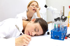Two Femal Scientists Asleep Royalty Free Stock Photos