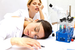 Two Femal Scientists Asleep Royalty Free Stock Photography