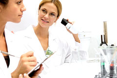 Two Femal Scientists Working Together Stock Images