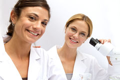 Two Femal Scientists Working Together Stock Image