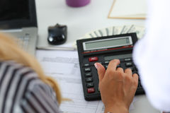 Two female accountants counting on calculator Stock Image