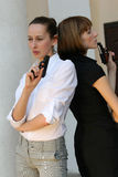 Two Female agents Royalty Free Stock Photos