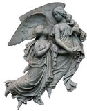 Two Guardian Angels with a Baby. Two female angels protect and carry an infant Royalty Free Stock Image