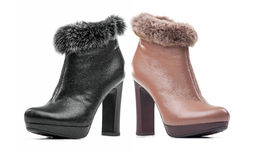 Two female ankle-high boots Royalty Free Stock Photos