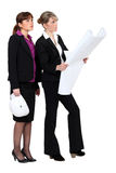 Two female architect stock images