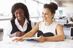 Two female architects working together at a desk in office Royalty Free Stock Photography