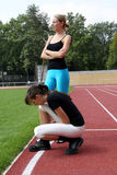 Two female athletes. Two young girls at the track royalty free stock photo