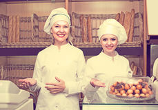 Two female bakers in bakery Royalty Free Stock Photo