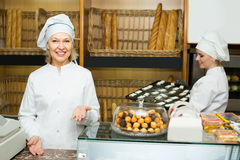 Two female bakers in bakery Stock Photos