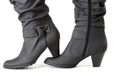 Two female black boots Royalty Free Stock Images