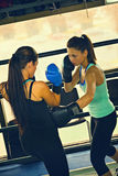 Two Female Boxers At Training Royalty Free Stock Photos