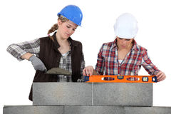 Two female bricklayers. Working together Royalty Free Stock Image