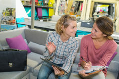 Two female business colleagues having chat Royalty Free Stock Photo