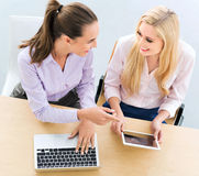 Two female business colleagues royalty free stock photos