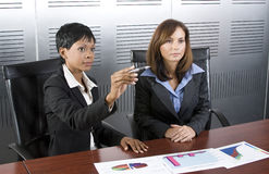 Two female business graph royalty free stock photo