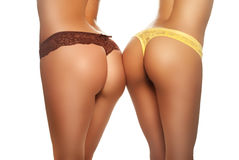 Two female buttocks Stock Image