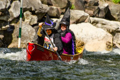 Two female canoeists dressed up in witch costumes Stock Photo