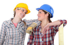 Two female carpenters chatting Royalty Free Stock Photography