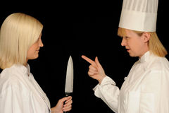 Two female chefs. Discussing cooking Royalty Free Stock Images