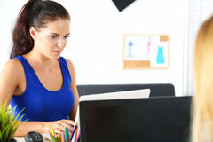 Two female clothes designers in office Royalty Free Stock Images