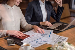 Two female colleagues doing work together in office Royalty Free Stock Images