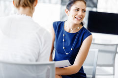 Two female colleagues in office Stock Images