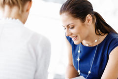 Two female colleagues in office Stock Photography