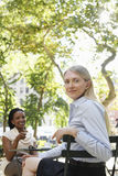 Two Female Colleagues At Street Cafe Royalty Free Stock Image