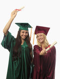Two female college graduates Stock Images