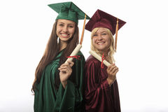 Two female college graduates Royalty Free Stock Images