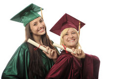 Two female college graduates Stock Photo