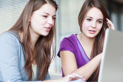 Two female college students in class Stock Photos