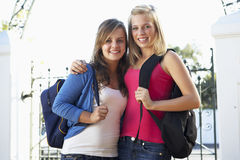 Two Female College Students Standing Outside Gate Royalty Free Stock Photo