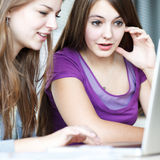 Two female college students working on a laptop Royalty Free Stock Image