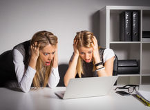 Two female coworkers looking at computer Stock Photography