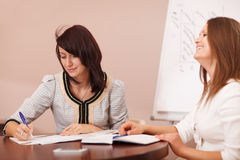 Two female coworkers in a meeting Stock Photo